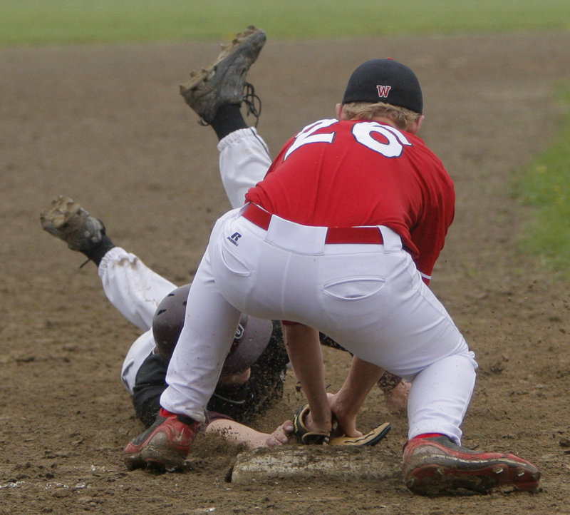 Third baseman Brandon Pridham of Wells puts the tag on Luke Saffian of Greely, who was attempting to steal Wednesday during Greely's 10-0 victory at Cumberland.
