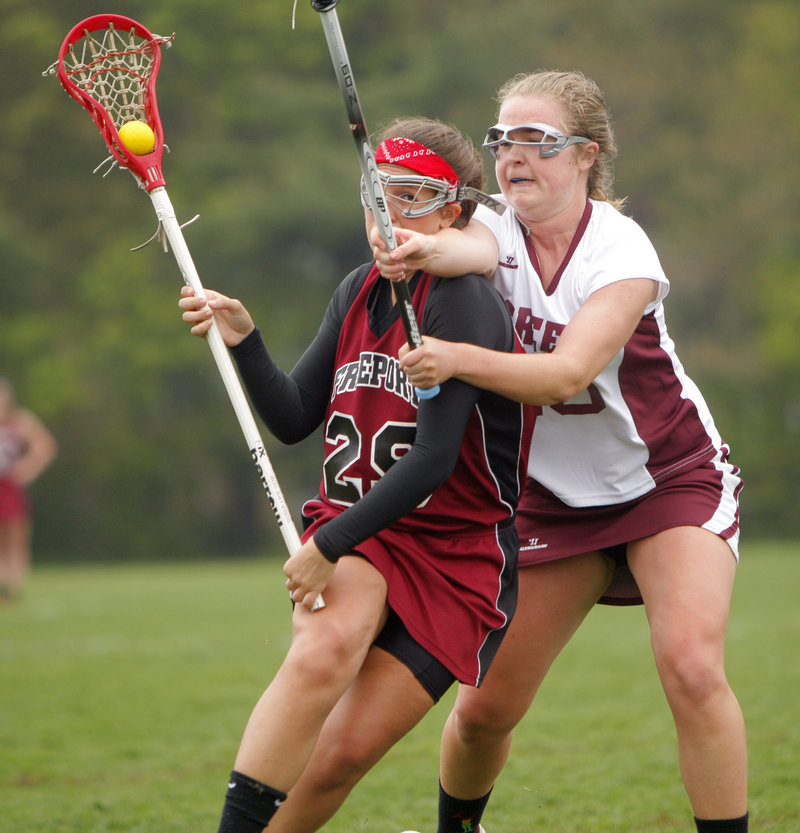 Alex Mitch of Freeport, left, looks for room to advance against Alicia Roost of Greely during Greely's 7-6 victory Thursday in girls' lacrosse at Cumberland.