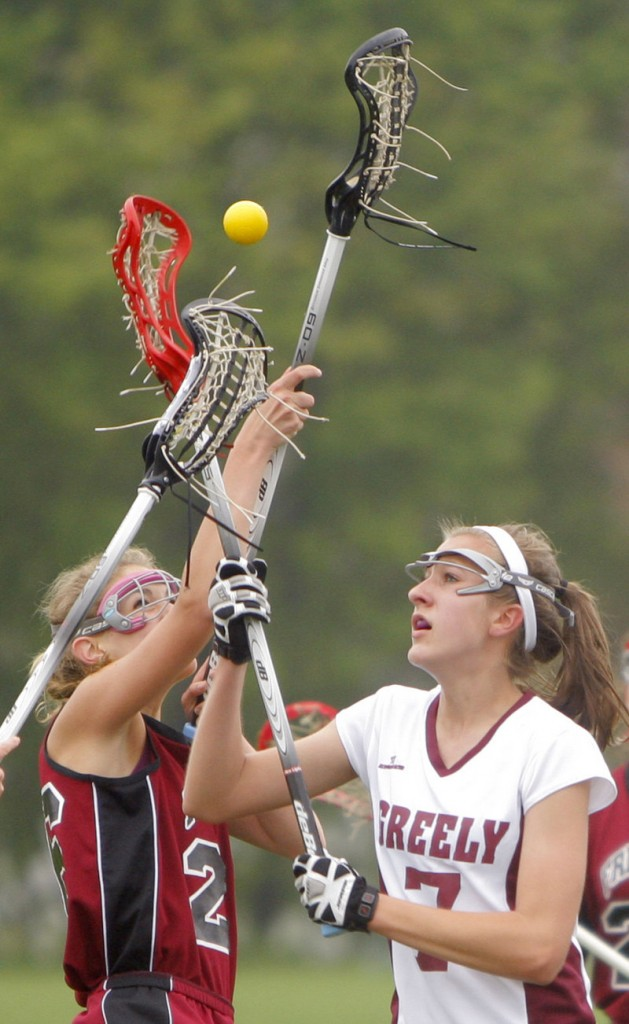 Three sticks are going after one ball Thursday in the Freeport-Greely girls' lacrosse game. Lauren Eastler, left, of Freeport contends with Julia Mitiguy of Greely. Greely won, 7-6.