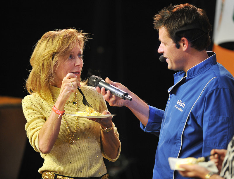 Cindy DiPalma of Portland was one of the lucky locals invited up on stage to taste the special dish made by Celebrity Chef Jon Ashton at the Relish Cooking Show, a Diva Event, at the Portland Expo on Thursday.