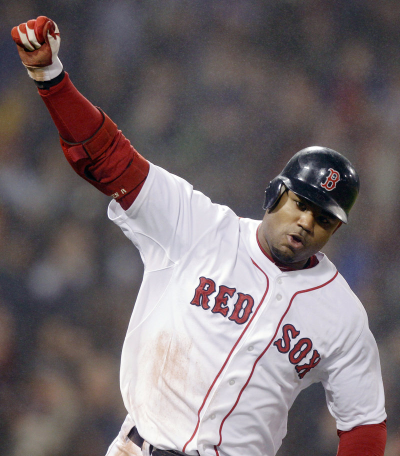 Carl Crawford pumps his fist Thursday night after hitting the bases-loaded single in the ninth inning that gave the Boston Red Sox a 4-3 victory against the Detroit Tigers.