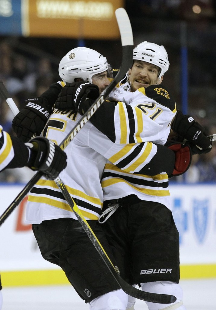 Andrew Ference, right, hugs Johnny Boychuk after scoring Thursday night for the Bruins in the third period of the 2-0 victory over Tampa Bay. Boston holds a 2-1 lead in the series.