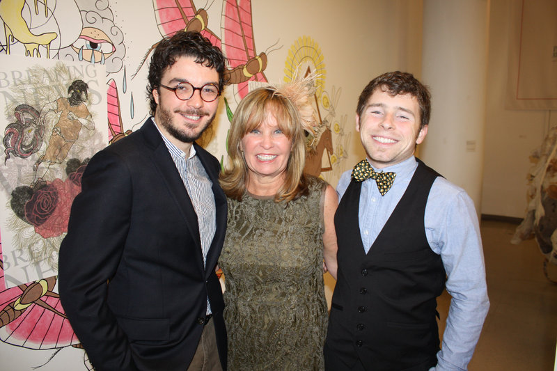 MECA's Board Chair Candace Pilk Karu, center, with her son, Tim Krueger Karu, left, and his husband, Jacob Krueger Karu.