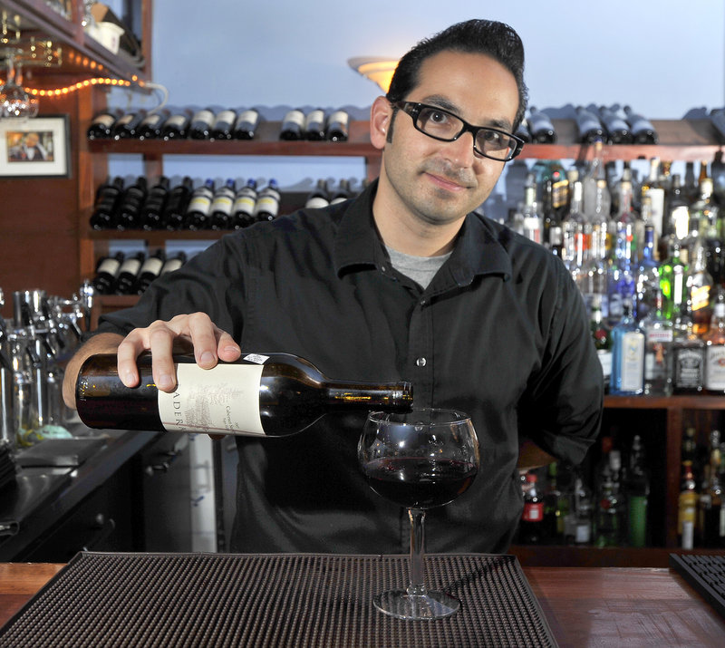 Conundrum Wine Bistro owner Vincent Migliaccio pours a glass of Ladera Cabernet, one of among 250 varieties he keeps on hand – some so rare that the cost runs more than $1,500 a bottle.