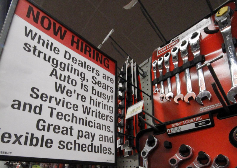 "A ""Now Hiring"" sign is posted near a display of wrenches at a Sears store in Bethel Park, Pa. The jobless rate fell last month in more than three-quarters of the nation's states, with companies feeling more confident in the U.S. economy."