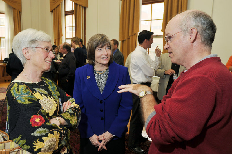 Portland's three city manager finalists convened with the public and city officials during a reception at Portland City Hall on Friday. Patricia Finnigan, center, the acting city manager, talks with former mayor Anne Pringle, left, and resident Steven Scharf.