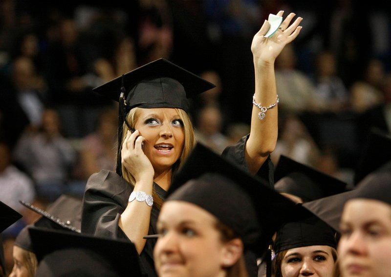 Audrey Grass of Sabattus looks for friends and family before the start of the University of New England's commencement at the Cumberland County Civic Center in Portland on Saturday. Grass received her degree in occupational therapy.