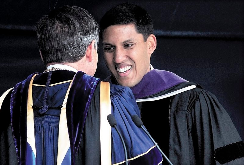 Speaker Rajiv Shah, right, is congratulated by Colby College President William Adams after Shah addressed the graduating class and received an honorary doctorate Sunday.