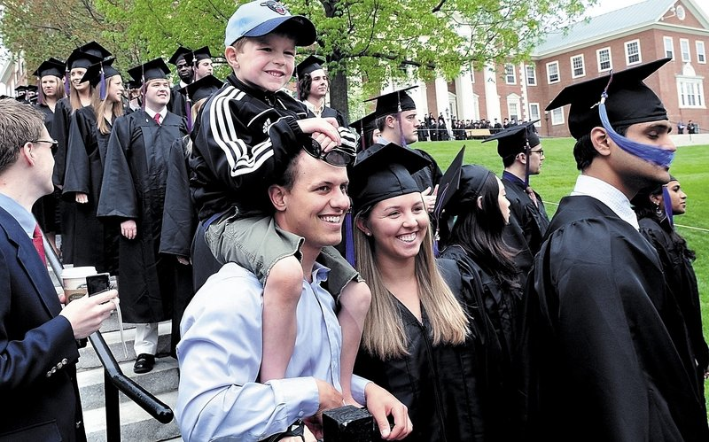Colby College graduate Allyson Cheever of Augusta is all smiles as her boyfriend, Brett Kaptina, and nephew Andrew Cheever pose for photos in Watervillle on Sunday.