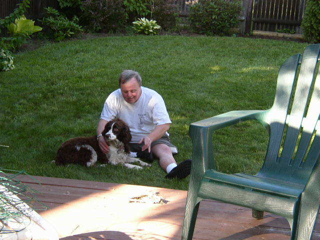 Jim Fox is shown with his springer spaniel, Molly, in his brother's backyard in South Portland in 2003.