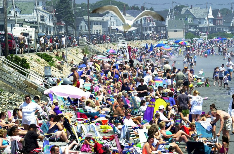 Sun lovers crowd Long Sands Beach in Cape Neddick on a hot and humid summer day.