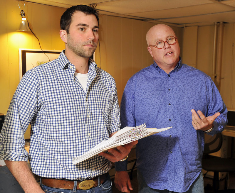 Ian Hayward, left, and Glenn Perry discuss the vote of the South Portland Planning Board on Tuesday night. Perry said he's invested about $55,000 in a plan to build Ebo's Market, but critics have halted the project.