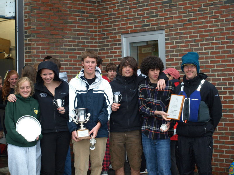 Falmouth High's sailing team, including Haley McMahon, left, Ellie MacEwan, Charlie Lalumiere, Francesco Montanari, Myles Everett, and Coach Michael McAllister, celebrate their win at the Maine State Championship Regatta in Castine last weekend. Lalumiere and MacEwan also won the individual title for the A Division.
