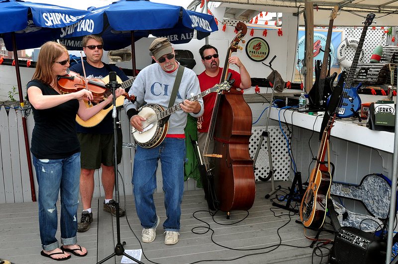 The band Jerks of Grass plays on the Portland Lobster Co. deck. The seafood restaurant in the heart of Portland's waterfront district has an extensive deck on Chandler's Wharf.