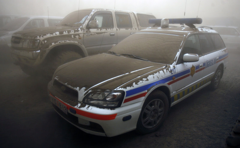 Vehicles are covered in ash near Kirkjubaearklaustur. Officials say the ash cloud will reach Scotland by today.