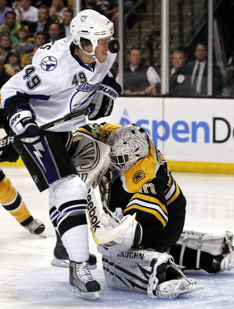 Tampa Bay's Blair Jones gets a close look at the rebound of a save by Boston goalie Tim Thomas on Monday night in Game 5 of the Eastern Conference finals. Thomas made 33 saves in the Bruins' 3-1 win.