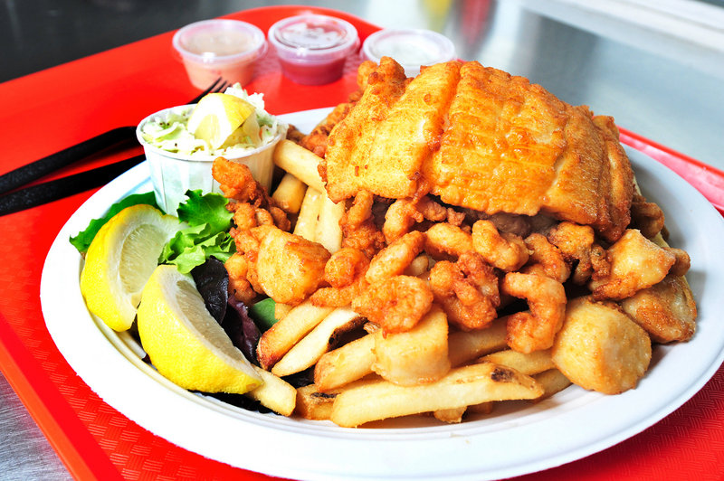 Portland Lobster Co.'s Fisherman's Platter consists of haddock, scallops, clams, french fries and coleslaw. Fried dinners run $10 and up.