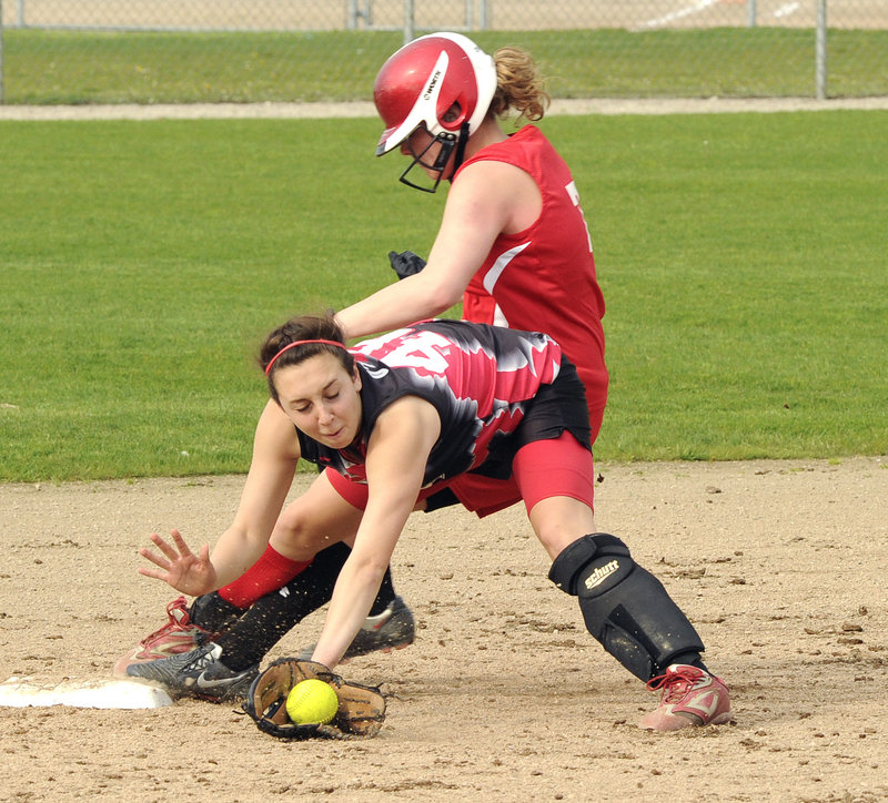 Libby Grant of South Portland is safe at second base Tuesday as Scarborough shortstop Marisa O'Toole fields a late throw on a bunt. Grant went on to score, and South Portland went on to win 3-1 and remain undefeated.