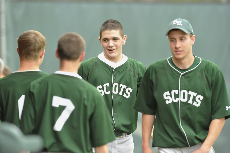 Evan Amell of Bonny Eagle, center, is welcomed by his teammates after hitting a grand slam in the second inning against Gorham.
