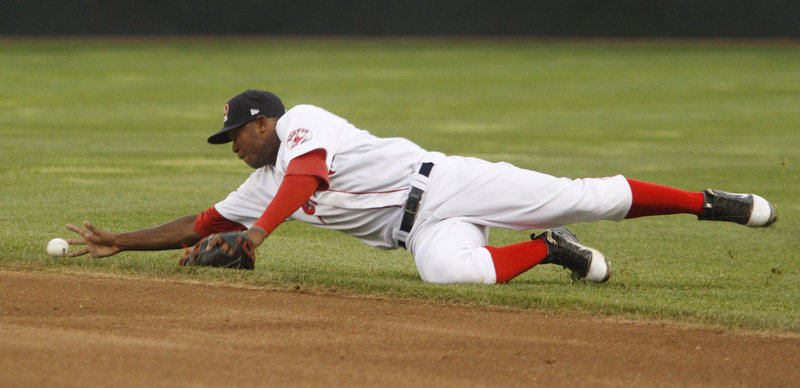 Sea Dogs second baseman Oscar Tejeda tries to barehand a ball that deflected of the glove of first baseman Jorge Padron during Portland's 8-3 loss to New Hampshire.