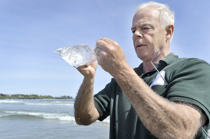 Scarborough resident Bill Donovan seals a water sample in a plastic bag during training on Wednesday. By the end of June, nearly 200 volunteer monitors will be trained.