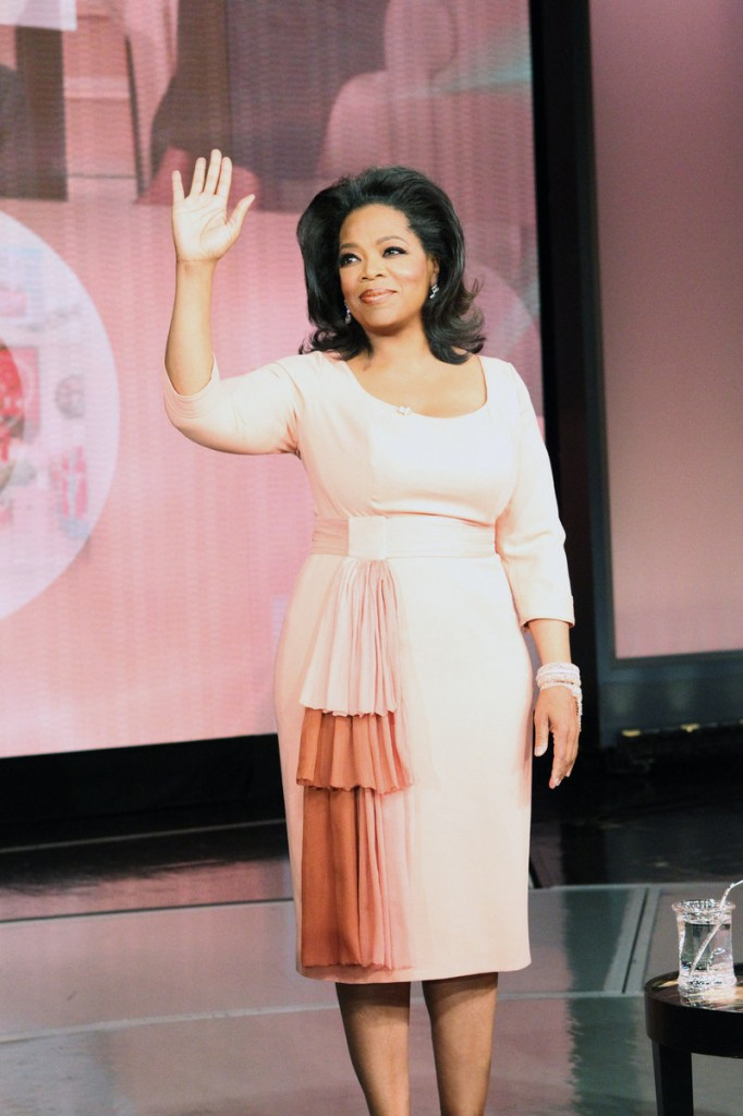 "Oprah Winfrey waves as her show tapes for the last time Tuesday in Chicago. After 25 years, Winfrey said she felt ""genuine kindness, affection and trust"" from viewers."