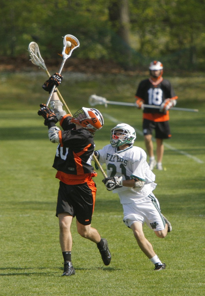 Finn Hadlock of North Yarmouth Academy hauls in a long pass Wednesday while defended by Forrest Chap of Waynflete during Waynflete s 11-7 victory at home in schoolboy lacrosse.