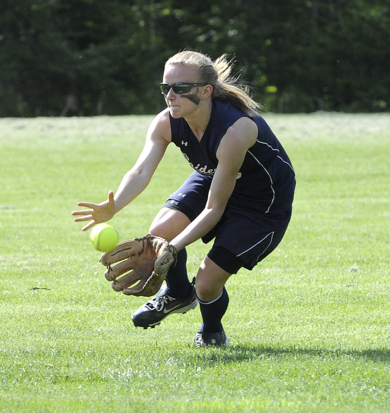 Brianna Pelkie of Fryeburg Academy races in to snare a low line drive Wednesday all part of a strong defense that helped the Raiders come away with an 11-1 victory against Lake Region.