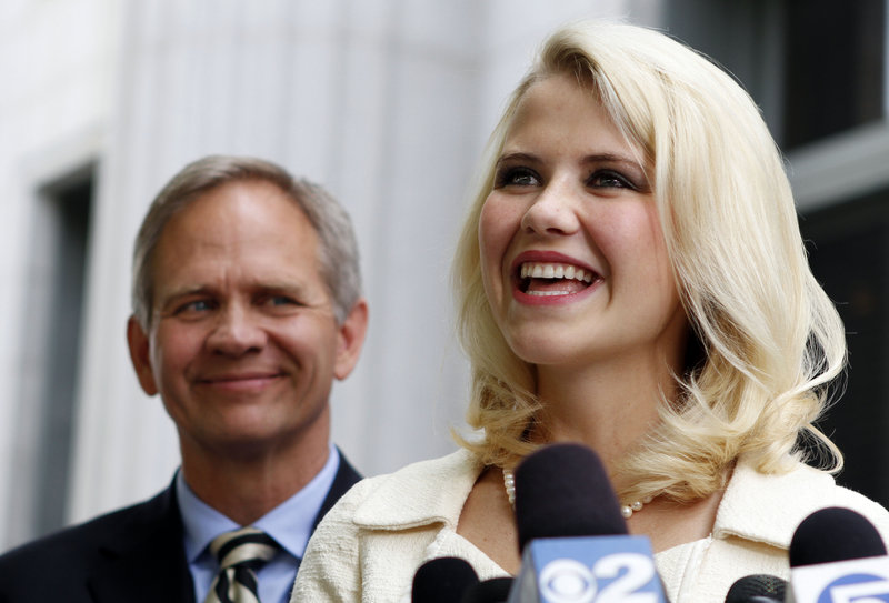 Elizabeth Smart and her father, Ed Smart, talk to the media Wednesday in Salt Lake City. She said the sentencing marks the end of a long chapter in her life – and a new beginning.