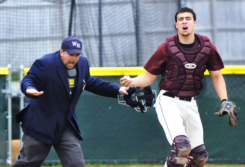 Windham catcher Cody Laberge reacts Thursday after Nic Lops of Cheverus was ruled safe on a sixth-inning squeeze, scoring the run that gave the Stags a 3-2 victory at home. Cheverus improved to 12-1. Windham is 7-7.