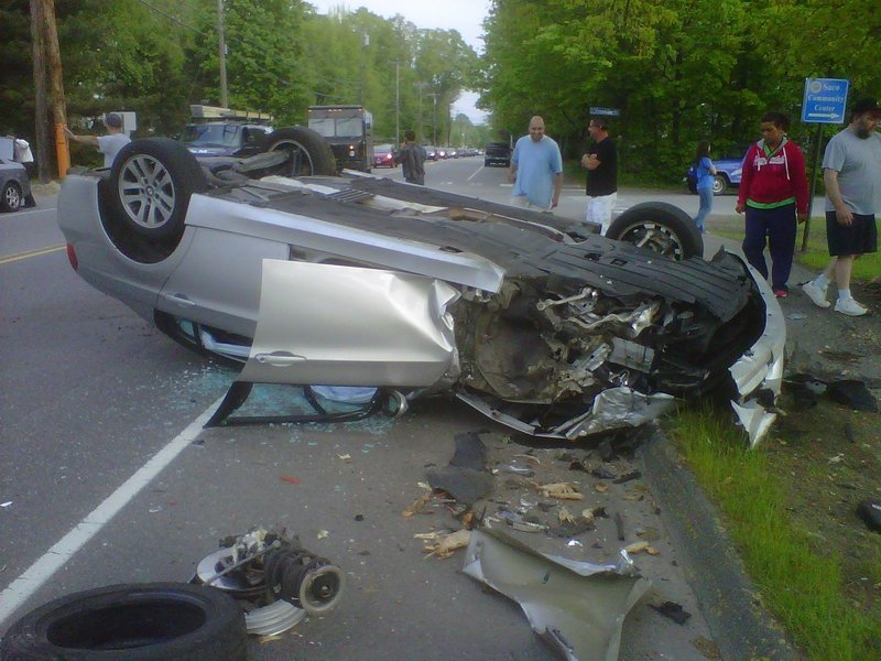 A 2007 BMW was badly damaged Thursday evening when the driver lost control and rolled on North Street in Saco.