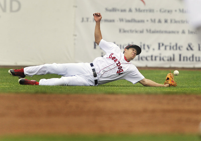 Right fielder Chih-Hsien Chiang of the Portland Sea Dogs just misses coming up with a shallow fly ball Thursday night during the 13-7 loss to the New Hampshire Fisher Cats.