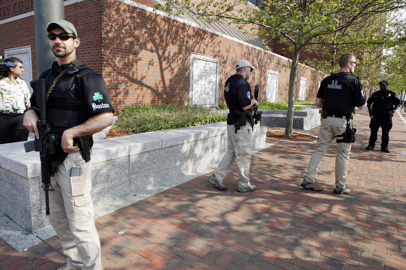 Armed U.S. marshals form part of the tight security for the governor, who is not accused of any crime.