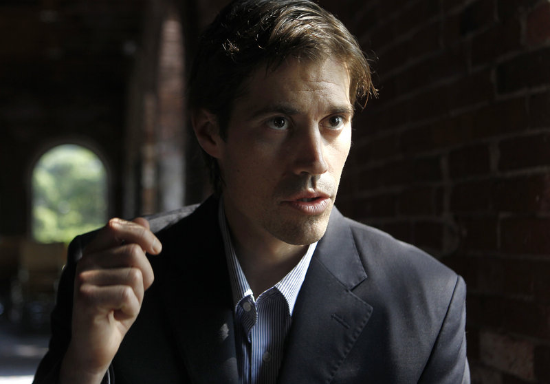 Journalist James Foley of Rochester, N.H., responds to questions during an interview in Boston Friday about his imprisonment in Libya.