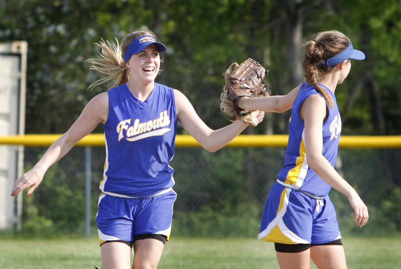 Left fielder Sarah Sparks, left, is congratulated by shortstop Jessie L Heureux of Falmouth after hauling down a high fly ball in the fourth inning Friday during a 3-1 victory against Sacopee Valley in a Western Maine Conference softball game at Falmouth.