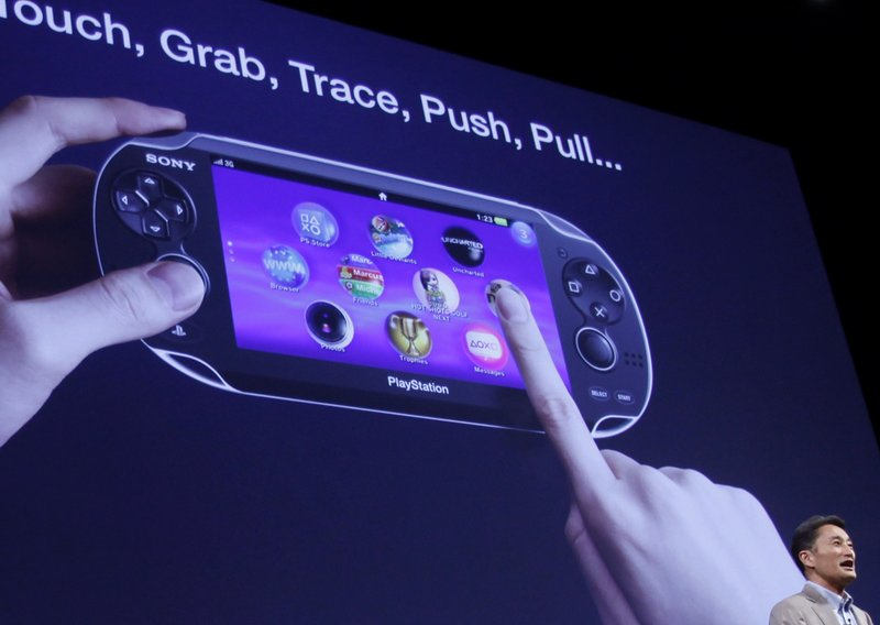 "Sony Computer Entertainment CEO Kazuo Hirai discusses how to use its new PlayStation Portable ""NGP"" at a Tokyo conference. Since mid-April, a series of breaches has compromised data in more than 100 million online accounts."