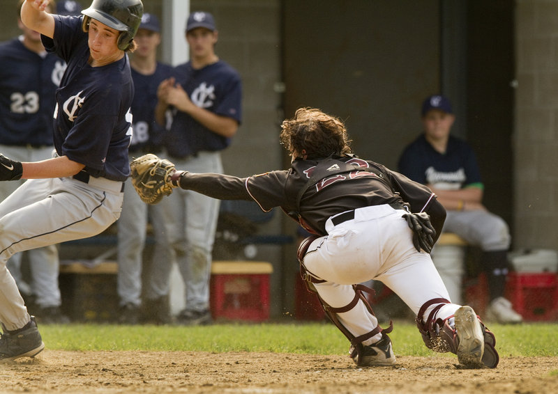 Joey King of Yarmouth avoids a tag attempt by Greely catcher Pete Stauber to score Friday in the fourth inning. King scored on a two-run single by Ryan Cody – part of a comeback from a 5-0 deficit that gave the Clippers a 6-5 victory in a Western Maine Conference game at home.