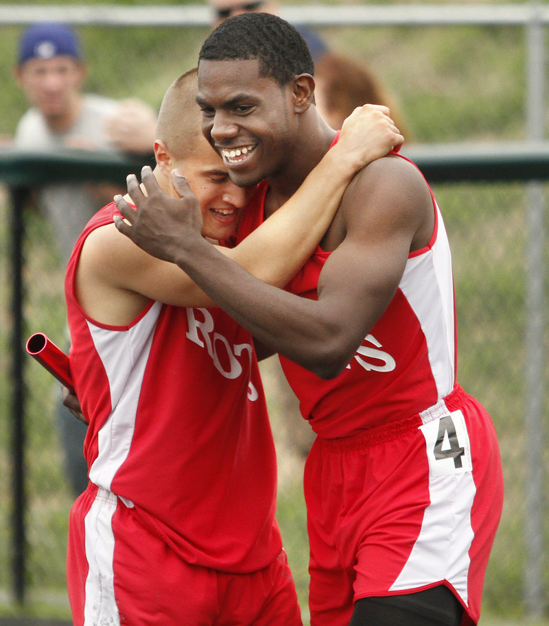 Teddy LeFay, left, and Adrian Reid of South Portland celebrate Saturday after helping the Red Riots win the 400-meter relay in the SMAA meet at Scarborough.
