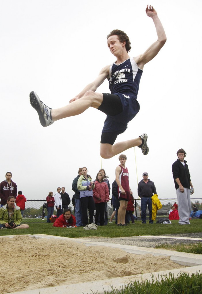 Asa Arden of Yarmouth gives his best effort in the triple jump. Jack Peters of Gray-New Gloucester won the event with a distance of 42-5 3/4.