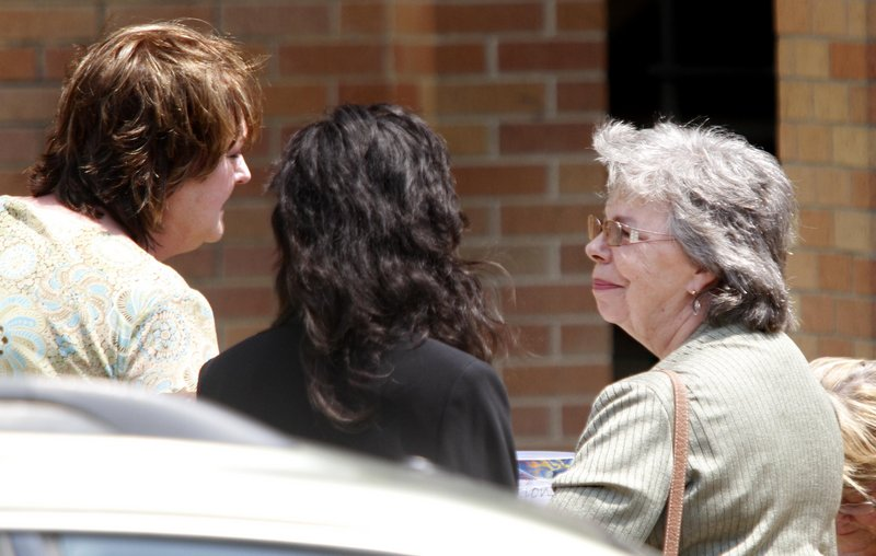 LuRae McCrery, right, grandmother of Camden Hughes, is consoled by friends after Camden's memorial service Saturday at Calvary Baptist Church in Grand Prairie, Texas. Her daughter, Julianne McCrery of Irving, Texas, is charged in the boy's death.