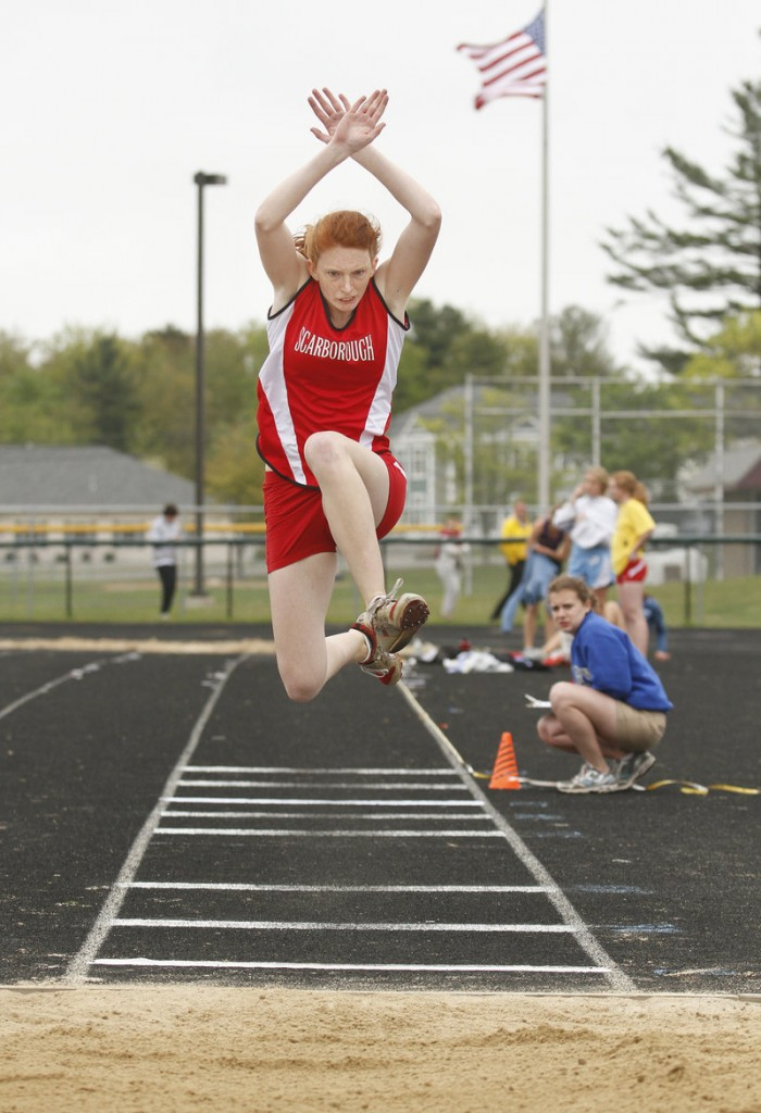 Emilia Scheemaker of Scarborough looks for a perfect landing while competing in the triple jump.