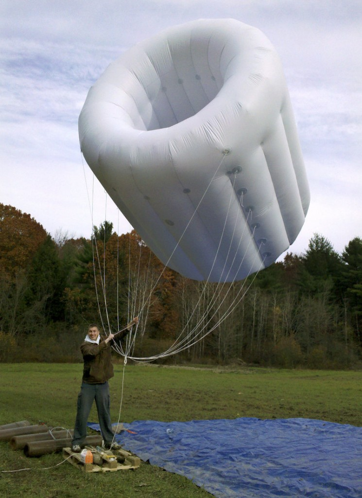 This November 2010 photo show Altaeros Energies' Adam Rein with a prototype airborne power turbine shroud in Amesbury, Mass.