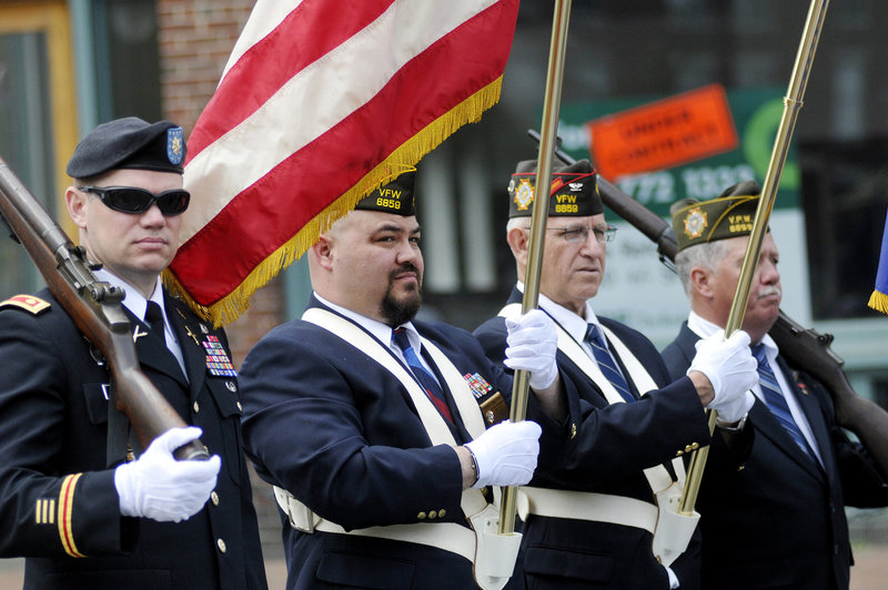 Members of Veterans of Foreign Wars Post 6859 in Portland from left, Todd Mitchell, Steve San Pedro, Bob Bernard and Rick Cobb, prepare to march in the parade. The VFW post's chaplain, the Rev. Bill Doughty, was grand marshal of Monday's parade.