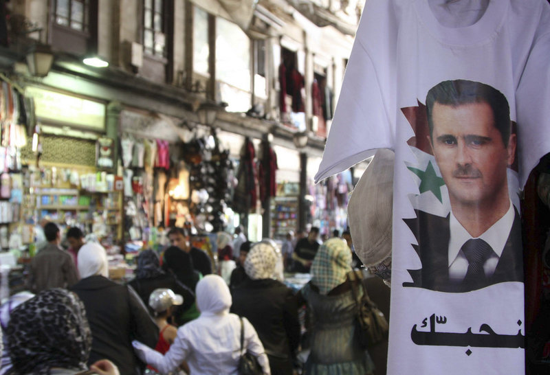 Syrian President Bashar Assad's image adorns a T-shirt in Damascus on Monday. What began as a disparate movement demanding reforms has erupted into a resilient uprising for his ouster. Rights groups say more than 1,000 people have been killed in the crackdown.
