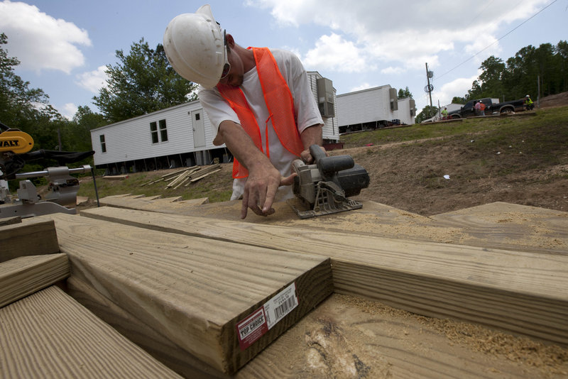 Anthony Massie of Lexington, Tenn., works to install FEMA trailers for tornado victims in Phil Campbell, Ala., on May 9. Nearly a third of the city of Joplin, Mo., was damaged by a tornado May 22. FEMA said it will consider bringing in trailers if enough homes are not available.