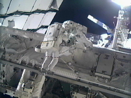 Astronauts Greg Chamitoff and Mike Fincke work on the exterior of the International Space Station during the fourth spacewalk of the STS-134 mission.