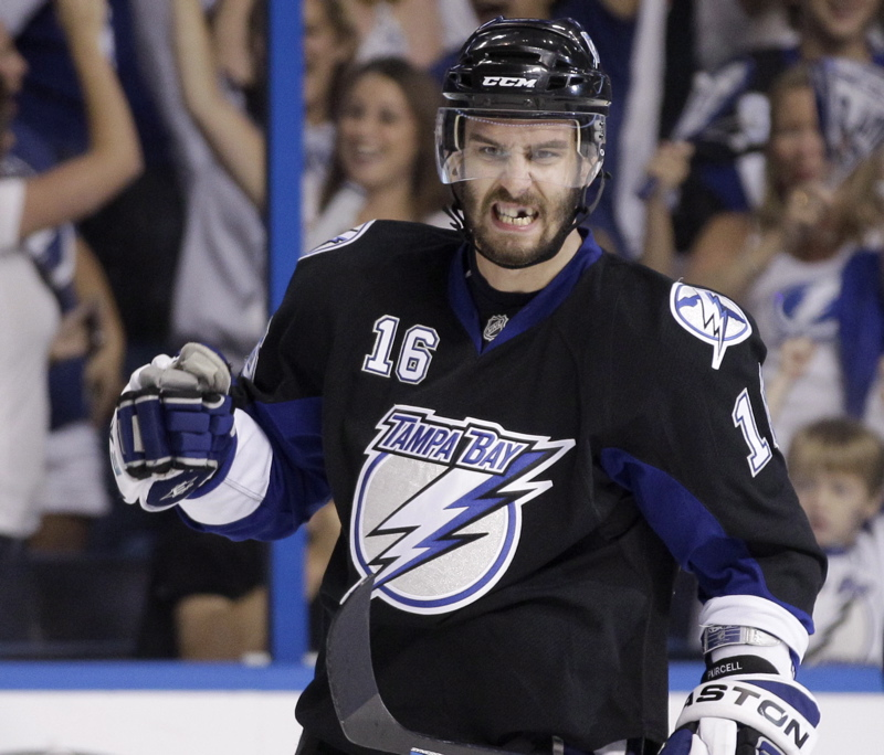 Teddy Purcell of Tampa Bay, a former UMaine player, celebrates a goal today in Game 4 of the Eastern Conference finals at St. Petersburg, Fla. The Lightning rallied from a three-goal deficit to win 5-3, tying the series, 2-2. Purcell had two goals in the second period.