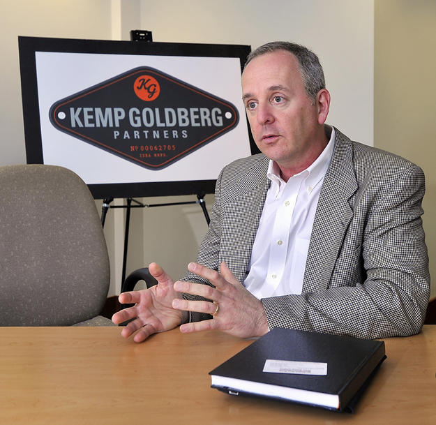 David Goldberg, founding partner of Kemp Goldberg, talks about the process of contracting with national clients and the positive effect of headquartering in Portland. The company's new logo is in the background.