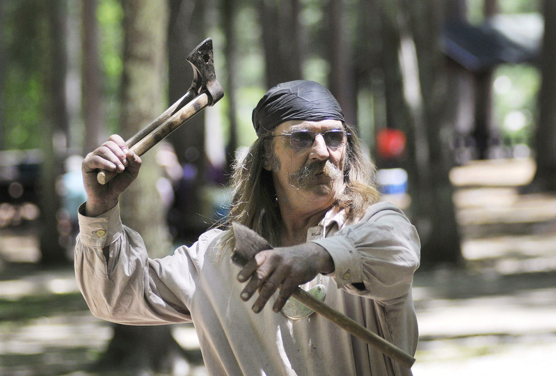 "Dave Bryant of Mount Vernon throws tomahawks at a target. ""I'm really good at it,"" he said. ""It's also something that we let the public try if they want."""