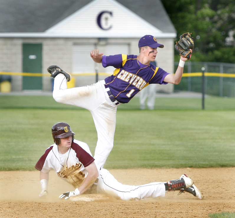 Mitchell Powers of Cheverus shows the umpire he's still got the ball after tagging out Thornton Academy's Jeff Gelinas. Top-ranked Cheverus advanced in the Western Class A playoffs Friday with a 5-2 victory.